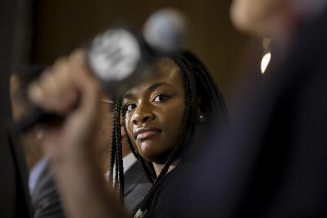 In this Feb. 26, 2019, photo, Claressa Shields listens during a news conference in New York for her upcoming middleweight championship bout against Germany's Christina Hammer. (AP Photo/Bebeto Matthews)