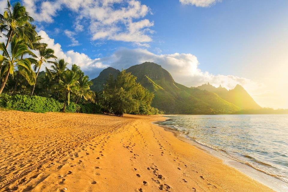 "<p>The sun sets on the tropical beach of <a href=""https://www.tripadvisor.com/Tourism-g29218-Kauai_Hawaii-Vacations.html"" rel=""nofollow noopener"" target=""_blank"" data-ylk=""slk:Kauai"" class=""link rapid-noclick-resp"">Kauai</a>, an island nicknamed ""the Garden of Isle"" in the Central Pacific. </p>"