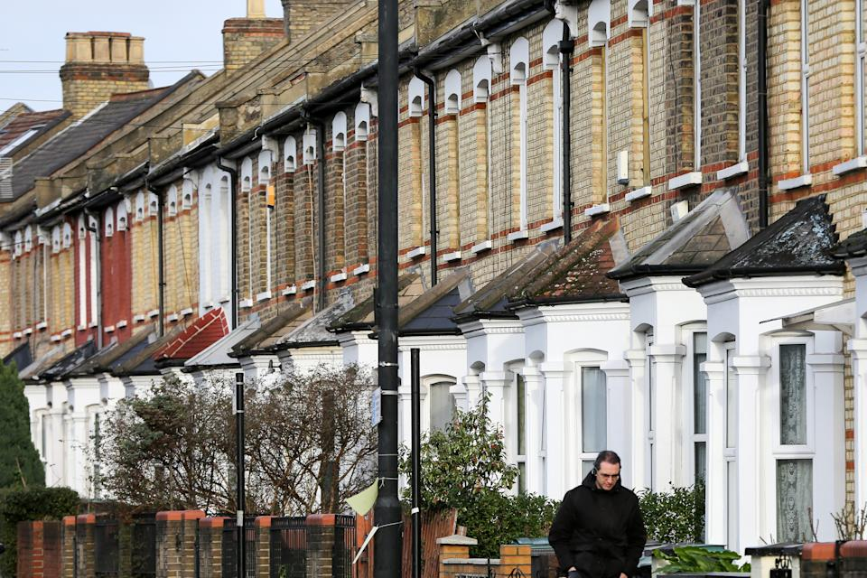 A man walks past terraced houses in London. According to the Right move�s latest house price index, as many as 100,000 will miss the stamp duty holiday, which ends on 31 March 2021. (Photo by Dinendra Haria / SOPA Images/Sipa USA)