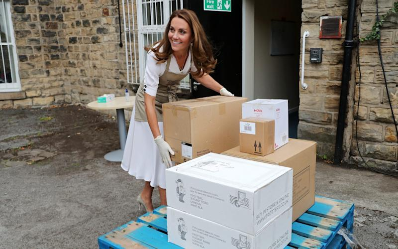 The Duchess helps unloads a pallet of supplies at Baby Basic UK - Chris Jackson/Getty