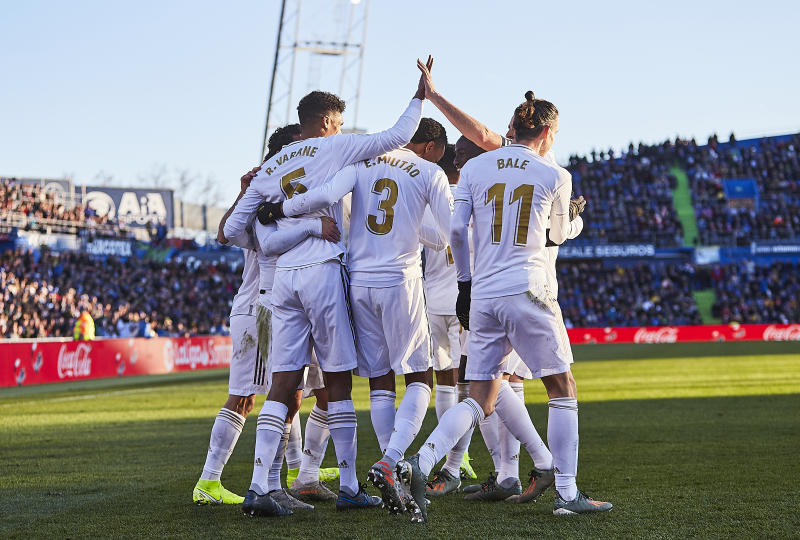 GETAFE, SPAIN - JANUARY 04: Raphael Varane of Real Madrid CF celebrates scoring his team's second goal with teammates during the Liga match between Getafe CF and Real Madrid CF at Coliseum Alfonso Perez on January 04, 2020 in Getafe, Spain. (Photo by Quality Sport Images/Getty Images)
