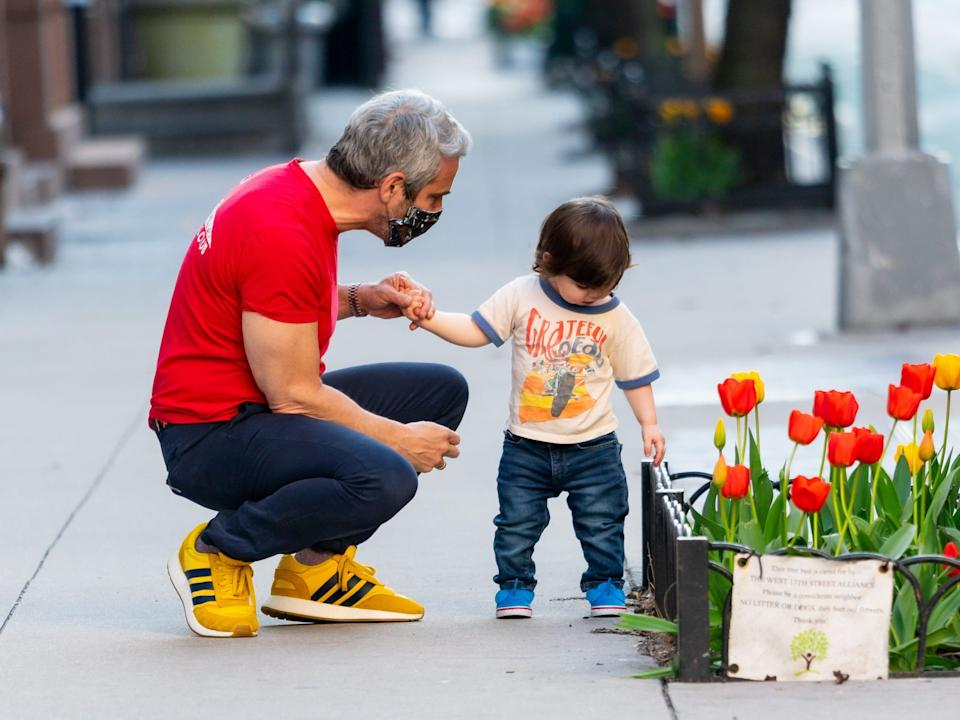 Andy Cohen on a walk with his son.