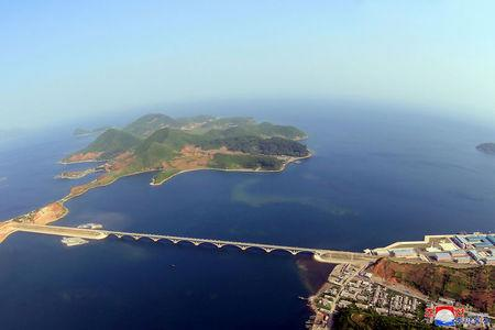 FILE PHOTO: An aerial photo shows the completed railway bridge across Sokjon Bay, part of the completed Koam-Tapchon railway