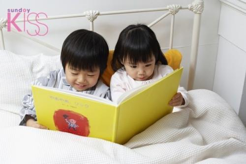 Boy and Girl Reading Picture Book