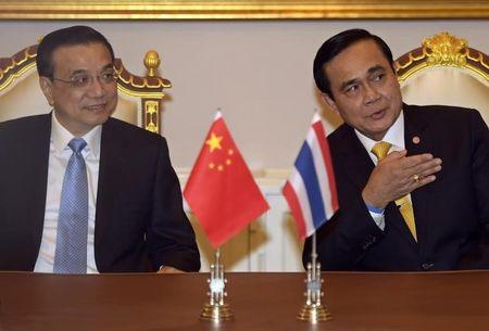 Thailand's Prime Minister Prayuth gestures as he talks with China's Premier Li at the Government House in Bangkok