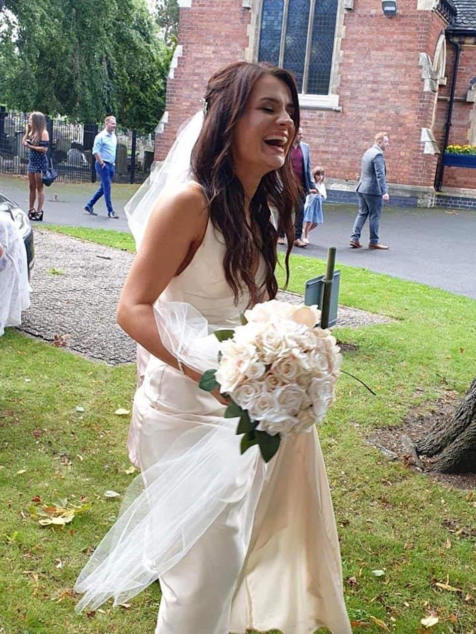 The bride bought her dress on ASOS and made her bouquet. (Caters)