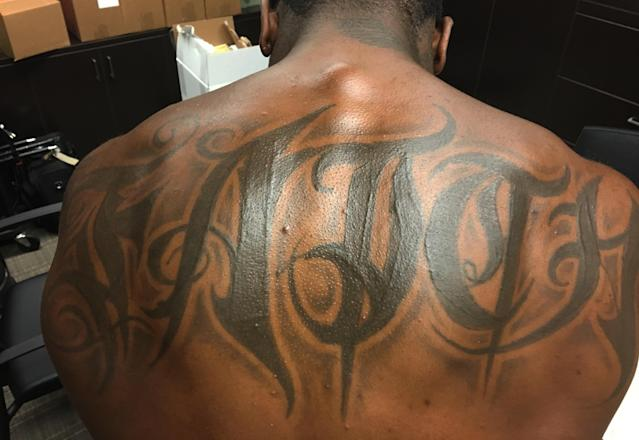 """<p>Navorro Bowman, LB, San Francisco. """"I got it when I was 17 years old. 'Faith.' That word means everything to me. It goes all through me. I am committed in everything I do. It's God, but it's more than just God. When you're down, have faith that you will get back up. My work ethic—faith. When people see that tattoo, they think how big it is. The size of it, to me, shows how important faith is in every aspect of my life.""""</p>"""