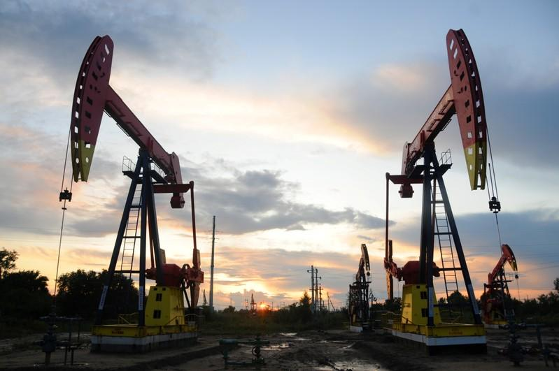 Oil slips after U.S. crude build and record production