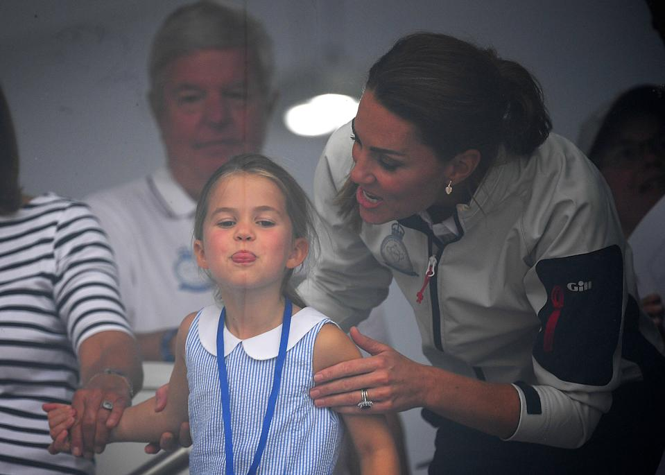 <p>Her mother, Kate, couldn't help but laugh when she spotted Charlotte poking her tongue out during the King's Cup regatta in 2019. (Clive Mason/Getty Images)</p>