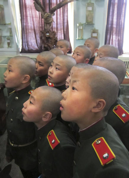 In this Thursday, April 18, 2013 photo, eleven-year-old students who were newly admitted into the Mangyongdae Revolutionary School, gather together inside a biology specimen room in Pyongyang, North Korea. The school is run by the military and school administrators say it was originally set up in 1947 for children who had lost their parents during Korea's fight for liberation from its Japanese occupiers. (AP Photo)