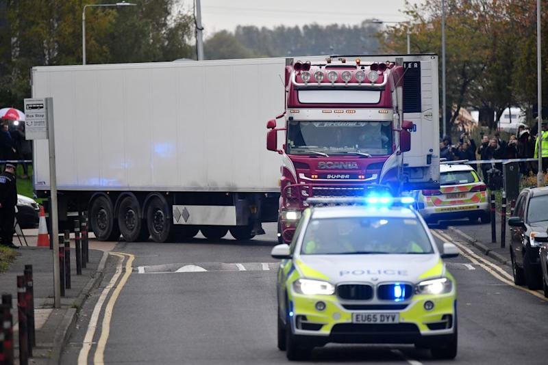 Police officers drive away a truck in which 39 dead bodies were discovered on Oct. 23, in the U.K. The victims are believed to be Vietnamese nationals. | Ben Stansall—AFP/Getty Images