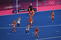 LONDON, ENGLAND - JULY 29: Marilyn Agliotti of Netherlands competes during the Women's Pool WA Match W02 between the Netherlands and Belgium at the Hockey Centre on July 29, 2012 in London, England. (Photo by Daniel Berehulak/Getty Images)