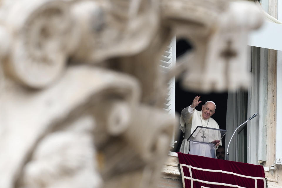 Pope Francis waves as he arrives for the Angelus noon prayer from the window of his studio overlooking St.Peter's Square, at the Vatican, Sunday, Oct. 3, 2021. (AP Photo/Alessandra Tarantino)