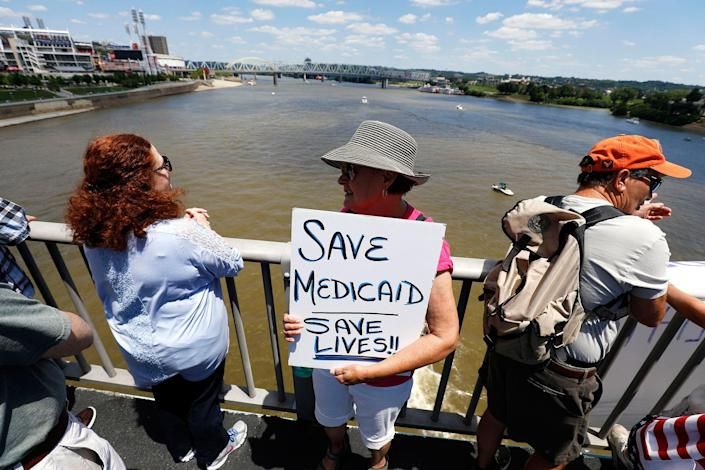"""<p>People protest at a """"Bridging the Gap For Healthcare Rally"""" on the Roebling Suspension Bridge July 9, 2017 in Covington, Ky. The rally was part of a day of healthcare-related protests in Covington, with another rally being held there tonight lead by Senator Bernie Sanders to urge Senate Majority Leader Sen. Mitch McConnell not to repeal the Affordable Care Act. (Photo: Bill Pugliano/Getty Images) </p>"""