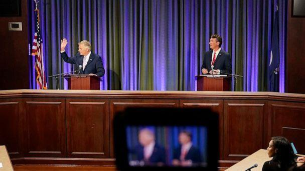 PHOTO: Democratic gubernatorial candidate former Governor Terry McAuliffe, left, and Republican challenger, Glenn Youngkin, prepare for a debate at the Appalachian School of Law in Grundy, Va., Sept. 16, 2021.  (Steve Helber/AP)