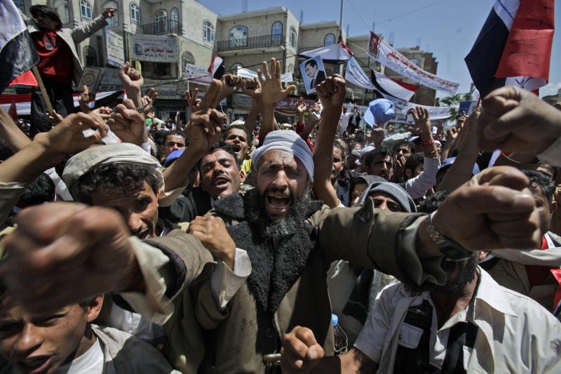 An anti-government protestor reacts during a demonstration demanding the resignation of Yemeni President Ali Abdullah Saleh, in Sanaa, Yemen, Tuesday, March 8, 2011. A Yemeni security official says about 2,000 inmates have staged a revolt at a prison in the capital, taken a dozen guards hostage and joined calls by anti-government protesters for the country's president to step down. The official says the unrest in the Sanaa prison erupted late Monday when prisoners set their mattresses ablaze and occupied the facility's courtyard. (AP Photo/Muhammed Muheisen)