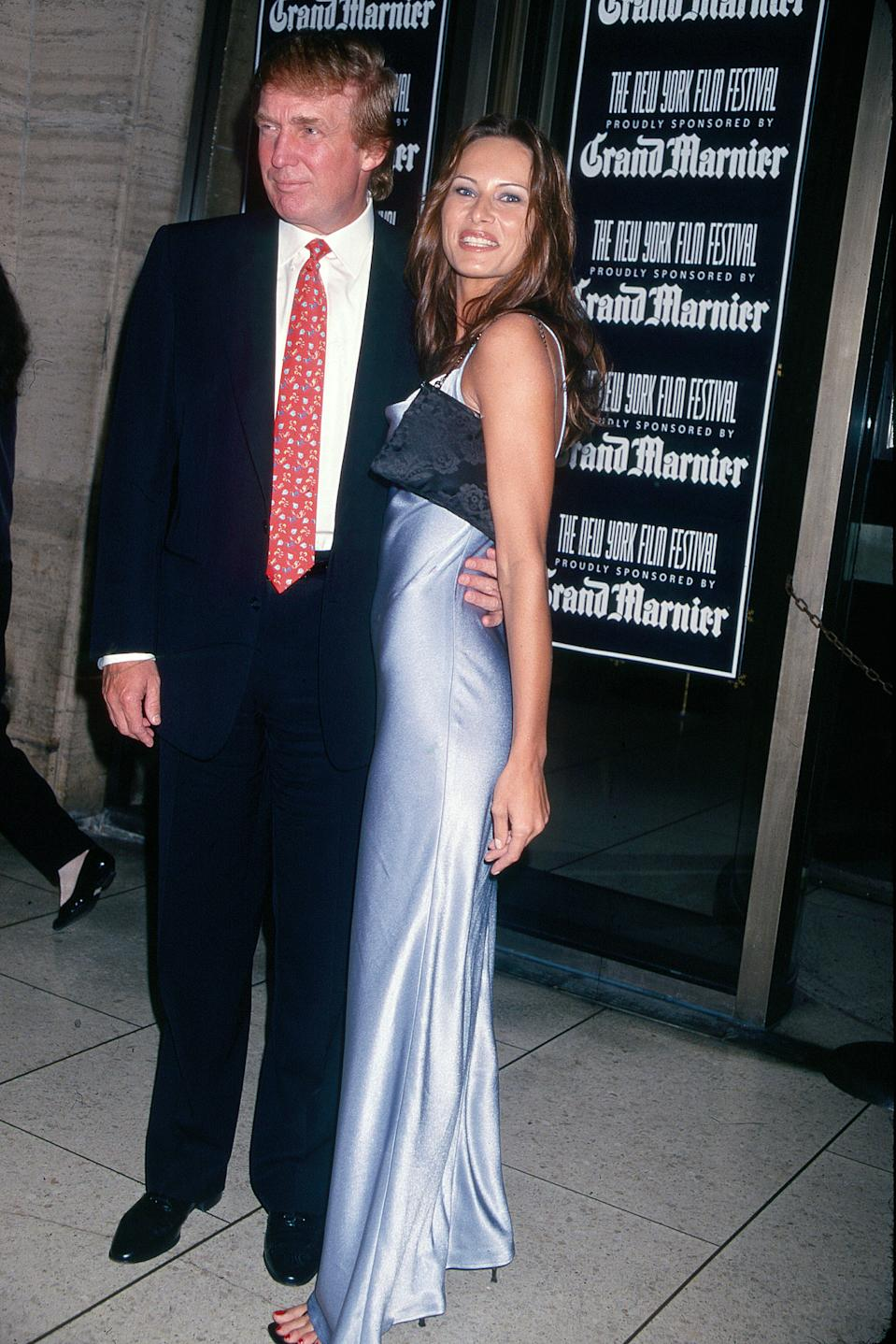 Portrait of American businessman Donald Trump and Melania Knauss (born Melanija Knavs) as they attend the New York Film Festival at Lincoln Center, New York, New York, 1998. (Photo by Rose Hartman/Getty Images)
