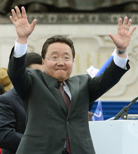In this Sunday, June 23, 2013 photo, Mongolia's incumbent President Elbegdorj Tsakhia of the ruling Democratic Party waves at his supporters during a campaign rally in Ulan Bator, Mongolia, for Wednesday's presidential elections. One of Mongolia's colorful traditional wrestlers is the main rival to corruption-busting Elbegdorj as residents of the vast, landlocked northern Asian nation and strong U.S. ally vote in the elections. (AP Photo/Kyodo News) JAPAN OUT, MANDATORY CREDIT
