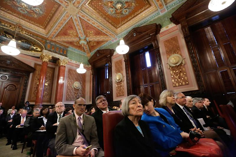 Illinois Rep. Barbara Flynn Currie, D-Chicago, front left, and Illinois Sen. Heather Steans, D-Chicago, right, talk while attending a Pension Committe hearing at the Illinois State Capitol Tuesday, Dec. 3, 2013, in Springfield, Ill. (AP Photo/Seth Perlman)