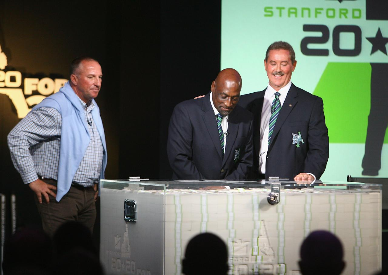 LONDON - JUNE 11:  Sir Allen Stanford shows Sir Ian Botham and Sir Viv Richards the 20 million Dollars  during the press conference for the Stanford 2020 tournament at Lords Cricket Ground on June 11, 2008 in London, England.  (Photo by Tom Shaw/Getty Images)
