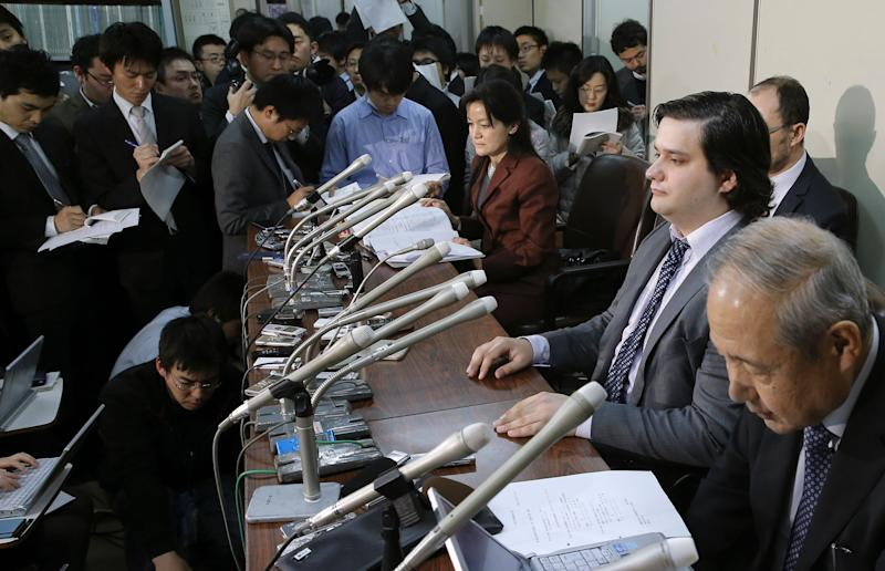 FILE - In this Feb. 28, 2014 file photo, Mt. Gox CEO Mark Karpeles, sitting at second right, attends a press conference at the Justice Ministry in Tokyo. The Mt. Gox bitcoin exchange in Tokyo is headed for liquidation after a court rejected its bankruptcy protection application. Mt. Gox said Wednesday, April 16, 2014, the Tokyo District Court decided the company, which was a trading platform and storehouse for the bitcoin virtual currency, would not be able to resurrect itself under a business rehabilitation process filed for in February. After Mt. Gox went offline in February, its CEO Mark Karpeles said that 850,000 bitcoins worth several hundred millions dollars were unaccounted for, blaming a weakness in the exchange's systems. (AP Photo/Kyodo News, File) JAPAN OUT, MANDATORY CREDIT