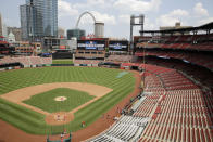 Members of the St. Louis Cardinals take the field during baseball practice at Busch Stadium Friday, July 3, 2020, in St. Louis. (AP Photo/Jeff Roberson)