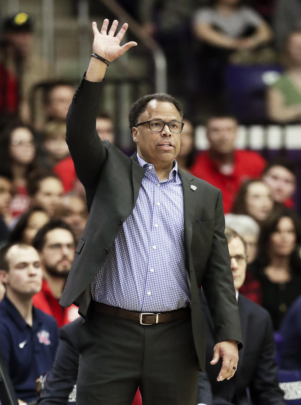 Liberty head coach Ritchie McKay signals to his players in the first half of the Atlantic Sun NCAA college basketball tournament championship game against Lipscomb Sunday, March 10, 2019, in Nashville, Tenn. (AP Photo/Mark Humphrey)