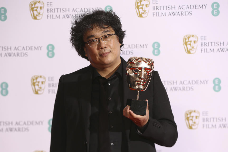 Director Bong Joon-ho holds the Best Foreign Language Bafta Award for the film Parasite, backstage at the Bafta Film Awards, in central London, Sunday, Feb. 2, 2020. (Photo by Joel C Ryan/Invision/AP)