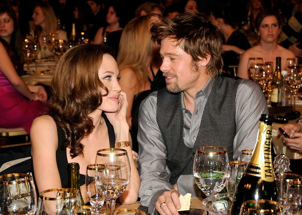 "America's sweethearts Angelina Jolie and Brad Pitt gaze lovingly at each other while seated at the ceremony. Kevin Mazur/<a href=""http://www.wireimage.com"" target=""new"">WireImage.com</a> - January 7, 2008"