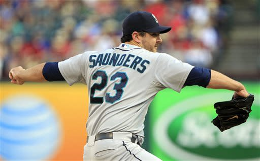 Seattle Mariners starting pitcher Joe Saunders throws a pitch during the first inning of a baseball game against the Texas Rangers Tuesday, July 2, 2013, in Arlington, Texas. (AP Photo/John F. Rhodes)