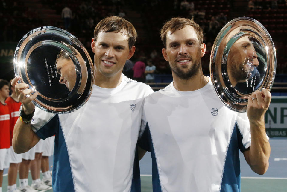 American's Bob Bryan, left, and Mike Bryan pose for the media with their trophy after the final doubles match at the ATP World Tour Masters tennis tournament at Bercy stadium in Paris, France, Sunday, Nov. 2, 2014. The Bryan brothers won 7-6, 5-7, 1-0(6). (AP Photo/Michel Euler)