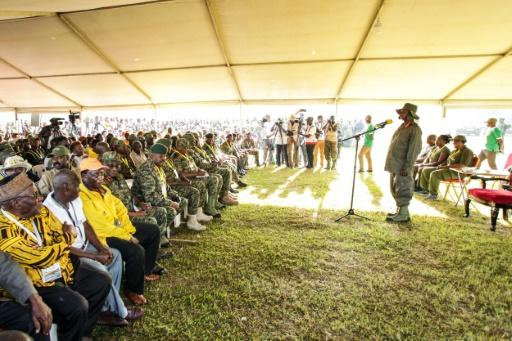 Ugandan President Yoweri Museveni and veterans and Members of Parliament, ready to march through the jungle as he retraces the route which his rebel forces took 35 years ago