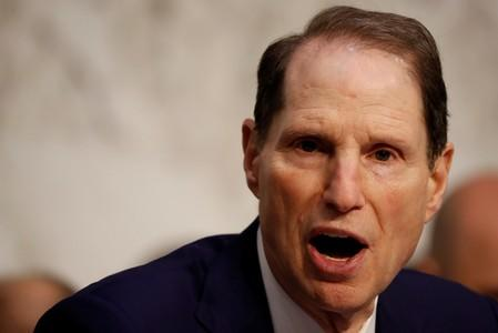 "Sen. Ron Wyden (D-OR) speaks during a markup on the ""Tax Cuts and Jobs Act"" on Capitol Hill in Washington"