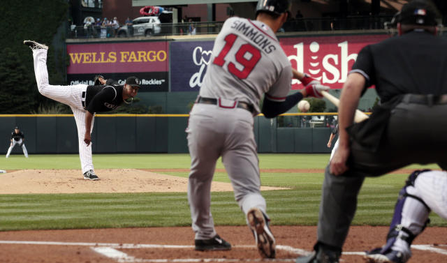 Atlanta Braves batter Andrelton Simmons (19) hits a grand slam home run off Colorado Rockies starting pitcher Juan Nicasio in the first inning of a baseball game in Denver on Tuesday, June 10, 2014. (AP Photo/Joe Mahoney)