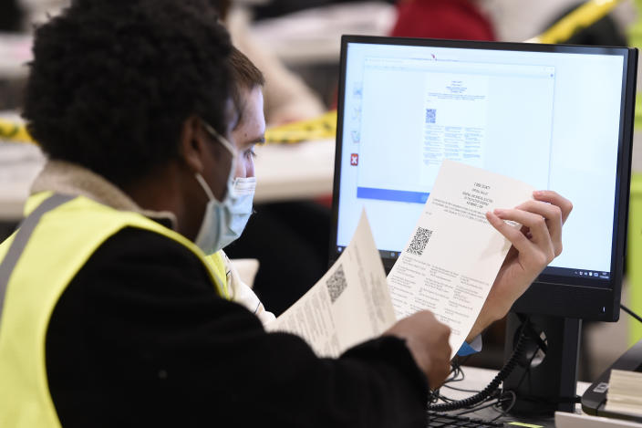 Cobb County Election officials look at ballots during a recount on Nov. 24, 2020, in Marietta, Ga. (Mike Stewart/AP)