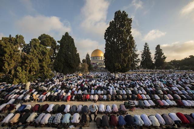 <p>Muslims perform Salat al Eid prayer at the Al-Aqsa mosque compound during the first day of the Eid Al Adha in Jerusalem on August 21, 2018. Muslims worldwide celebrate Eid Al-Adha, to commemorate the holy Prophet Ibrahim''s (Prophet Abraham) readiness to sacrifice his son as a sign of his obedience to God, during which they sacrifice permissible animals, generally goats, sheep, and cows. Eid-al Adha is the one of two most important holidays in the Islamic calendar, with prayers and the ritual sacrifice of animals. (Photo by Mostafa Alkharouf/Anadolu Agency/Getty Images) </p>