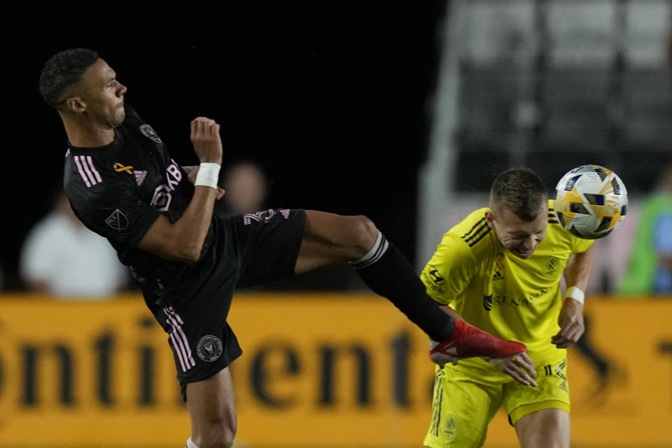 Inter Miami defender Kieran Gibbs, left, and Nashville defender Alistair Johnston vie for the ball during the first half of an MLS soccer match, Wednesday, Sept. 22, 2021, in Fort Lauderdale, Fla. (AP Photo/Rebecca Blackwell)