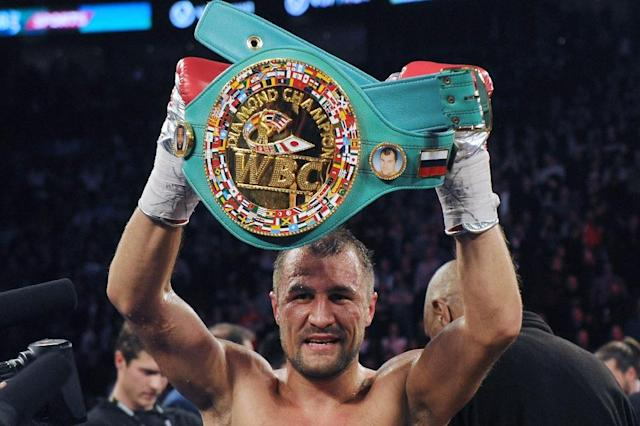 Sergey Kovalev stands with the WBC Light Heavyweight belt after defeating Jean Pascal (not pictured) during their Unified light heavyweight championship bout at the Bell Centre on March 14, 2015 in Montreal, Quebec, Canada (AFP Photo/Richard Wolowicz)