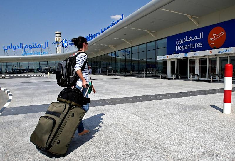 A traveller pulls her suite case at the newly opened Al Maktoum International Airport in Dubai, United Arab Emirates, Sunday, Oct. 27, 2013. The first passengers have arrived at Dubai's newest airport, part of the United Arab Emirates' plans to become a major air travel destination. The new airport is known by the code DWC for Dubai World Center. (AP Photo/Patrick Castillo, Emarat Al Youm)