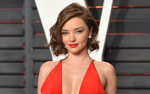 Not all of us are blessed with natural dimples, but model Miranda Kerr certainly is. [Photo: PA]