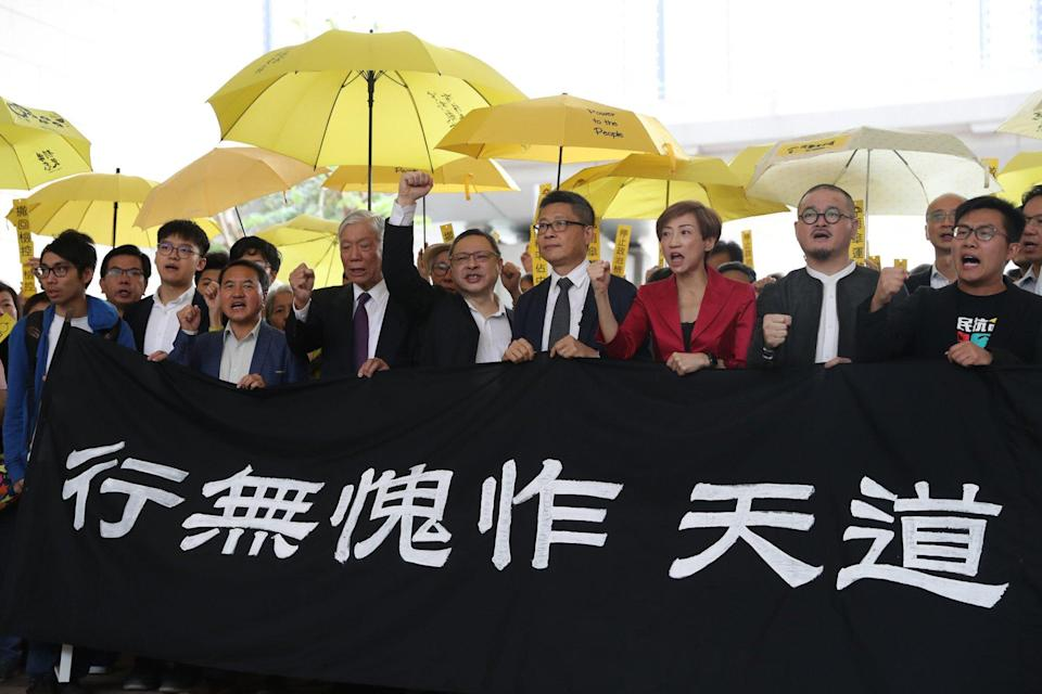 Nine key figures from Hong Kong's massive Occupy protests in 2014 protest outside the court before their 2018 trial. Photo: Dickson Lee