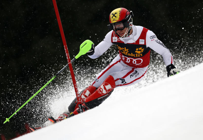 Austria's Marcel Hirscher speeds down the slope on his way to clock the eight fastest time during the first run of an alpine ski, men's World Cup slalom, in Kranjska Gora, Slovenia, Sunday, March 10, 2013. (AP Photo/Alessandro Trovati)