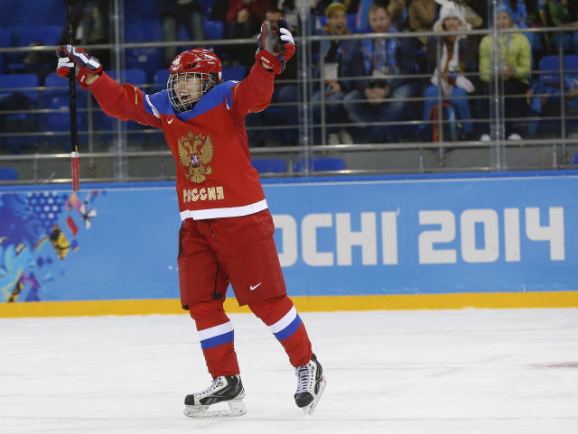 Olga Sosina of Russia celebrates her goal against Germany during the third period of the 2014 Winter Olympics women's ice hockey game at Shayba Arena, Sunday, Feb. 9, 2014, in Sochi, Russia. (AP Photo/Petr David Josek)