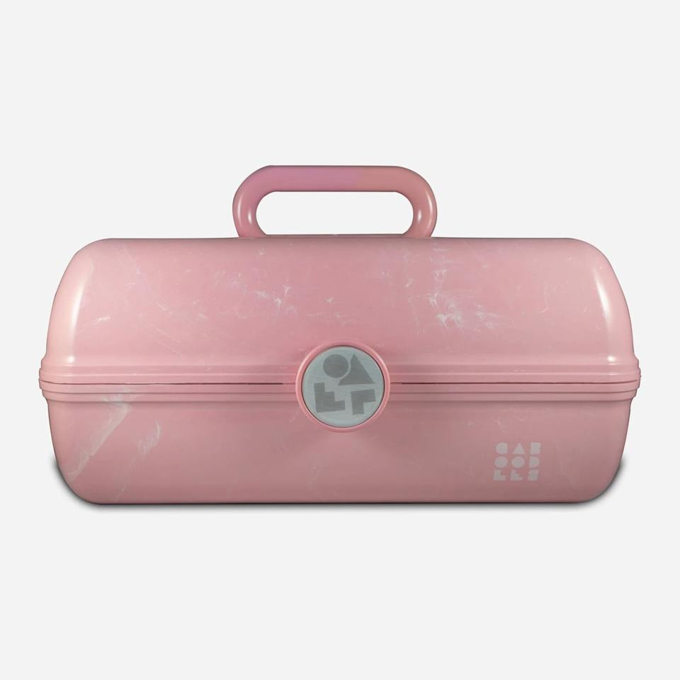 "<p>Pack all of your beauty essentials in the <a href=""https://www.popsugar.com/buy/Retro%20Caboodles%20On%20the%20Go%20Girl-Pink%20Marble-452843?p_name=Retro%20Caboodles%20On%20the%20Go%20Girl-Pink%20Marble&retailer=target.com&price=20&evar1=bella%3Aus&evar9=46210999&evar98=https%3A%2F%2Fwww.popsugar.com%2Fbeauty%2Fphoto-gallery%2F46210999%2Fimage%2F46211178%2FRetro-Caboodles-Go-Girl-Pink-Marble&list1=shopping%2Chair%2Cmakeup%2Ctarget%2Cbeauty%20products%2Cnails%2Cskin%2Csummer%20beauty&prop13=api&pdata=1"" rel=""nofollow"" data-shoppable-link=""1"" target=""_blank"">Retro Caboodles On the Go Girl-Pink Marble</a> ($20) for your next road trip.</p>"