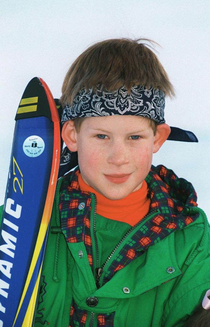 <p>Harry, 10, strikes a pose with his skis during a family trip to Klosters, Switzerland, an annual vacation destination for the British royal family. Ski fashion of the '90s was truly something special.</p>