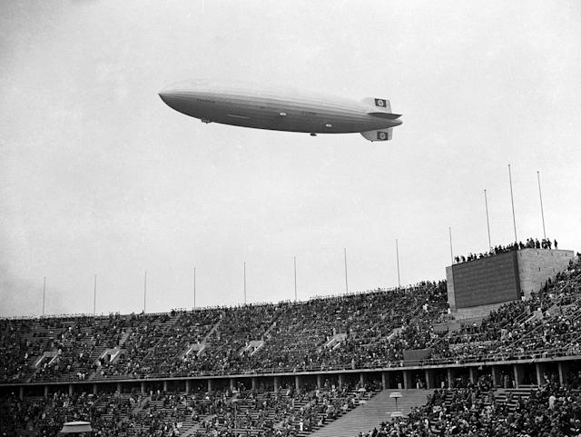 <p>The German airship Hindenburg flies over the Olympic Stadium, outside Berlin, on August 1, 1936, during the opening ceremony of the Olympic Games. (AP Photo) </p>