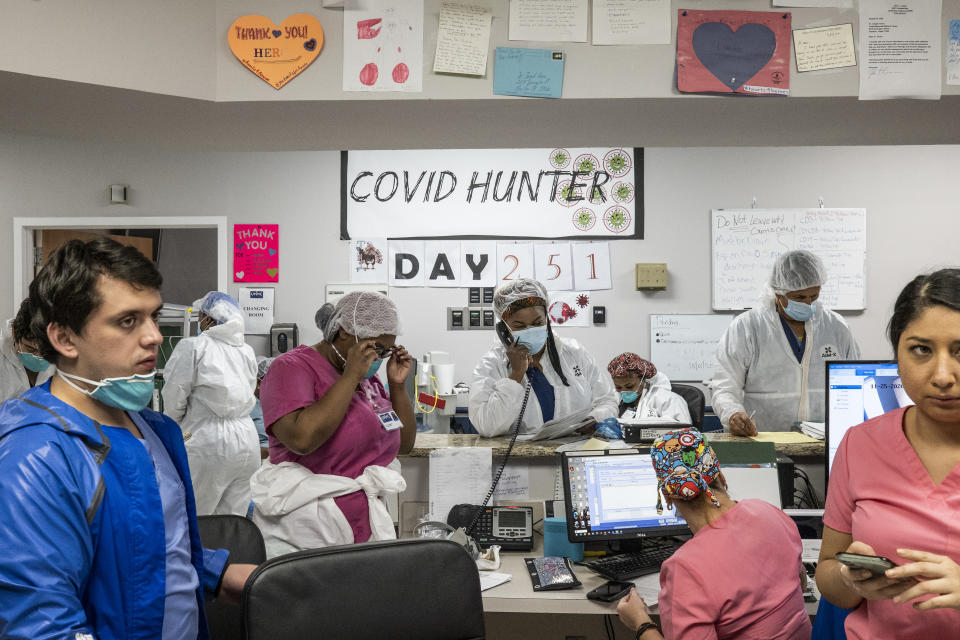 Staff in the nursing station as the numbers on the wall indicate the days since the hospital opened its Covid-19 ICU at the United Memorial Medical Center in Houston, Texas. Source:  Getty