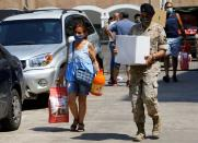 Lebanese army distributes aid to people in the aftermath of Beirut's massive explosion