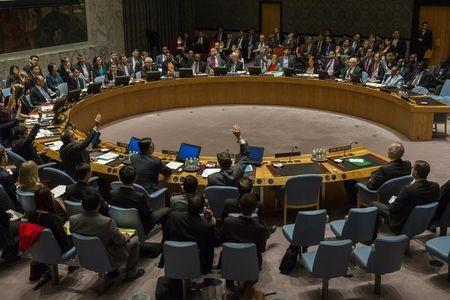 All members with the exception of Russia's Churkin and China's Wang vote in the UN Security Council in favor of referring the Syrian crisis to the ICC in New York