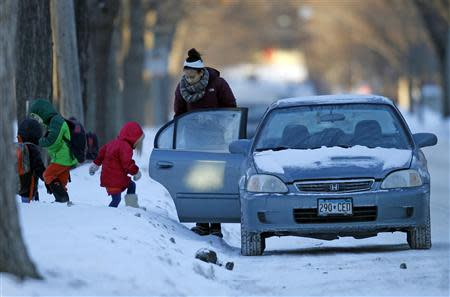 Kids climb into school-bound car in frigid Minnesota